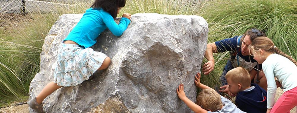 Young children in rock garden.